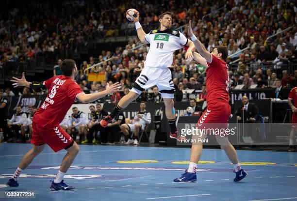 Drasko Nenadic of Team Serbien, Martin Strobel of DHB and Mijajlo Marsenic of Team Serbien during the game between Germany and Serbien at the...