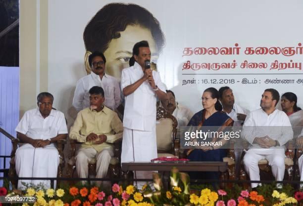 Dravida Munnettra Kazhagam party leader MK Stalin speaks as All India Congress Committee President Rahul Gandhi and and United Progressive Alliance...