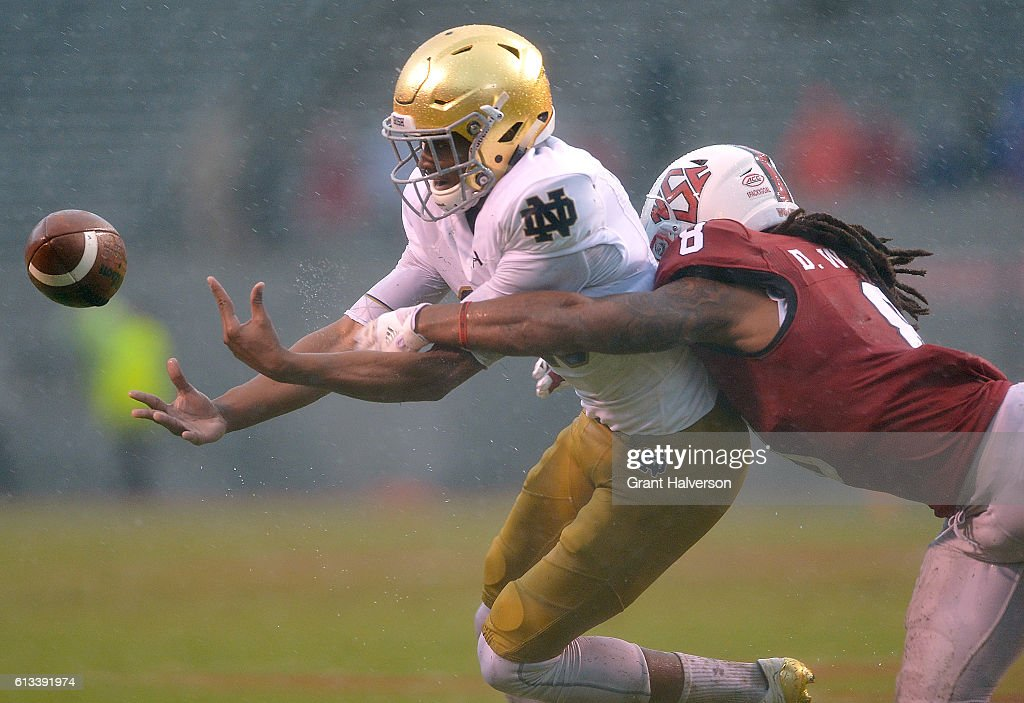 Dravious Wright #8 of the North Carolina State Wolfpack breaks up a pass intended for Kevin Stepherson #29 of the Notre Dame Fighting Irish during the game at Carter Finley Stadium on October 8, 2016 in Raleigh, North Carolina. North Carolina State won 10-3.