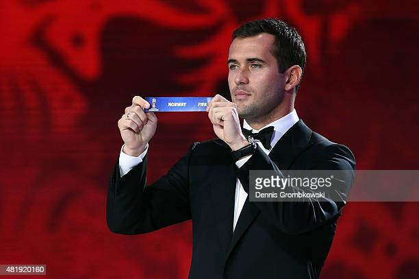 Draw assistant Alexander Kerzhakov holds up the name Norway during the European Zone draw at the Preliminary Draw of the 2018 FIFA World Cup in...
