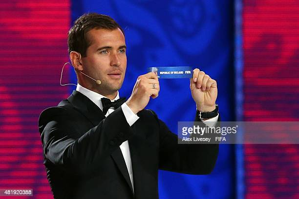 Draw assistant Alexander Kerzhakov holds up the name Republic of Ireland during the European Zone draw at the Preliminary Draw of the 2018 FIFA World...