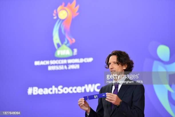 Draw Assistant Alexey Smertin shows D1 during the FIFA Beach Soccer World Cup Russia 2021 draw at the Home of FIFA on July 08, 2021 in Zurich,...