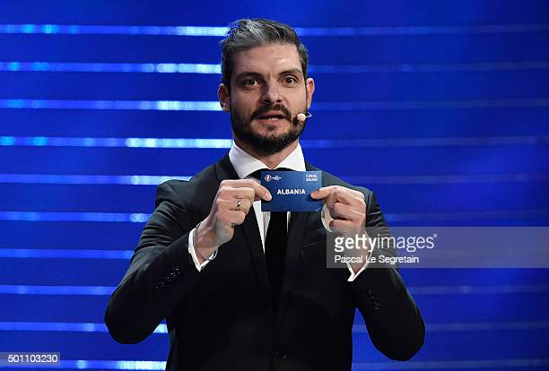 Draw assistant Angelos Charisteas draws out Albania in to Group A during the UEFA Euro 2016 Final Draw Ceremony at Palais des Congres on December 12...