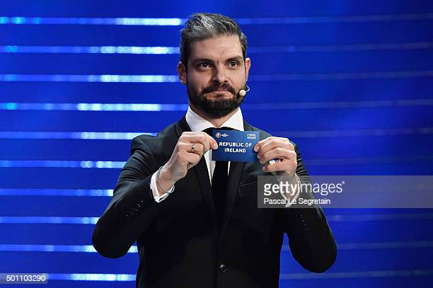 Draw assistant Angelos Charisteas draws out Republic of Ireland in to Group E during the UEFA Euro 2016 Final Draw Ceremony at Palais des Congres on...