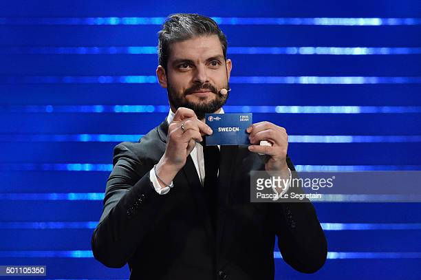 Draw assistant Angelos Charisteas draws out Sweden in to Group E during the UEFA Euro 2016 Final Draw Ceremony at Palais des Congres on December 12...