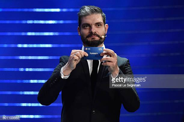 Draw assistant Angelos Charisteas draws out Turkey in to Group D during the UEFA Euro 2016 Final Draw Ceremony at Palais des Congres on December 12...