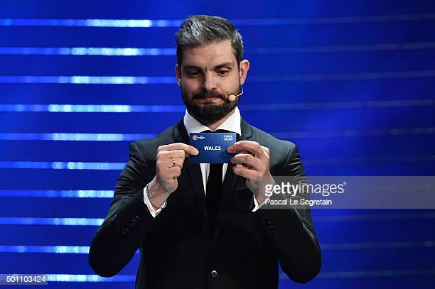 Draw assistant Angelos Charisteas draws out Wales in to Group B during the UEFA Euro 2016 Final Draw Ceremony at Palais des Congres on December 12...
