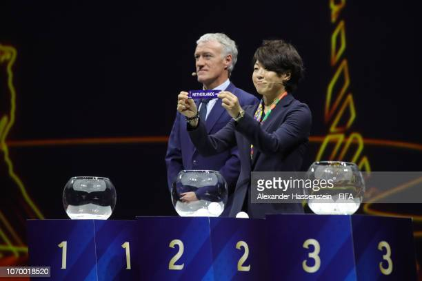Draw assistant Aya Miyama picks out Netherlands during the FIFA Women's World Cup France 2019 Draw at La Seine Musicale on December 8 2018 in Paris...