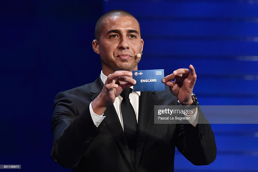 Draw assistant David Trezeguet draws out England in to Group B during the UEFA Euro 2016 Final Draw Ceremony at Palais des Congres on December 12, 2015 in Paris, France.