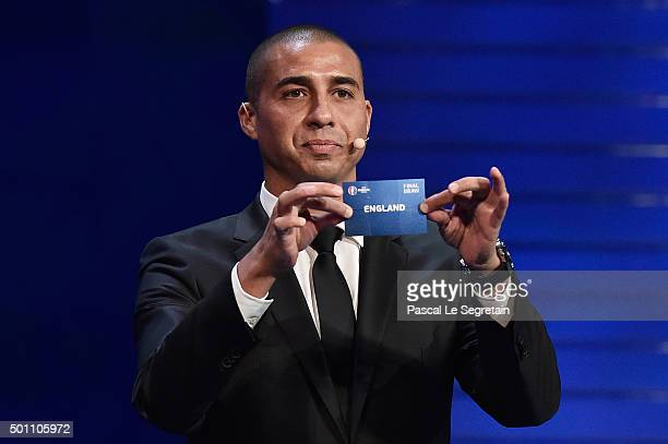 Draw assistant David Trezeguet draws out England in to Group B during the UEFA Euro 2016 Final Draw Ceremony at Palais des Congres on December 12,...