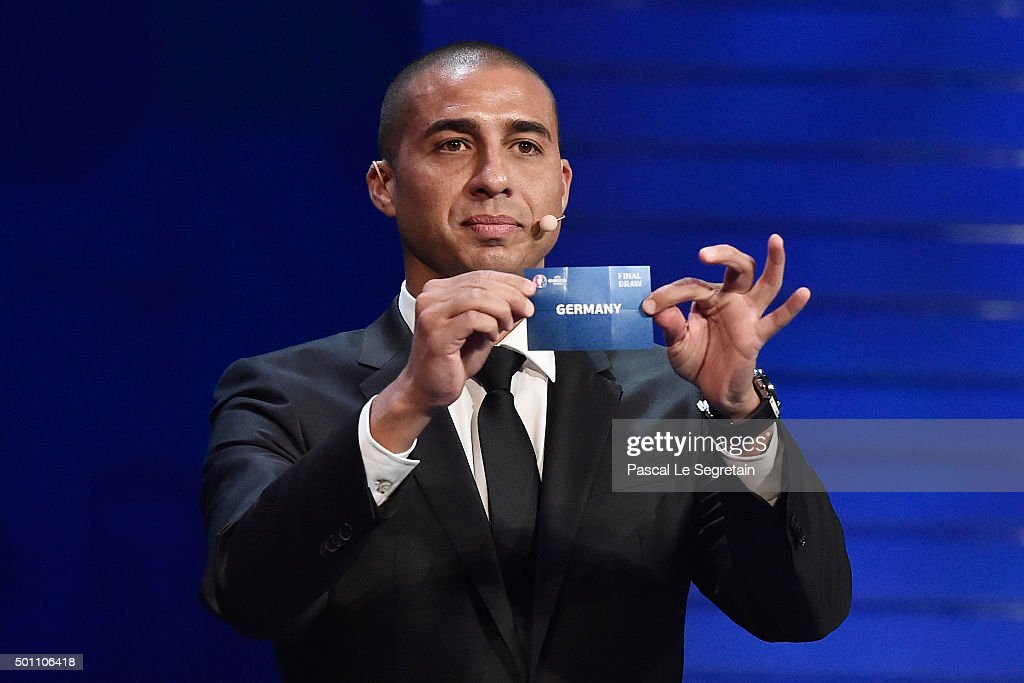 Draw assistant David Trezeguet draws out Germany in to Group C during the UEFA Euro 2016 Final Draw Ceremony at Palais des Congres on December 12, 2015 in Paris, France.