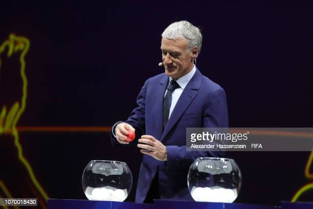 Draw assistant Didier Deschamps of France makes a pick during the FIFA Women's World Cup France 2019 Draw at La Seine Musicale on December 8 2018 in...