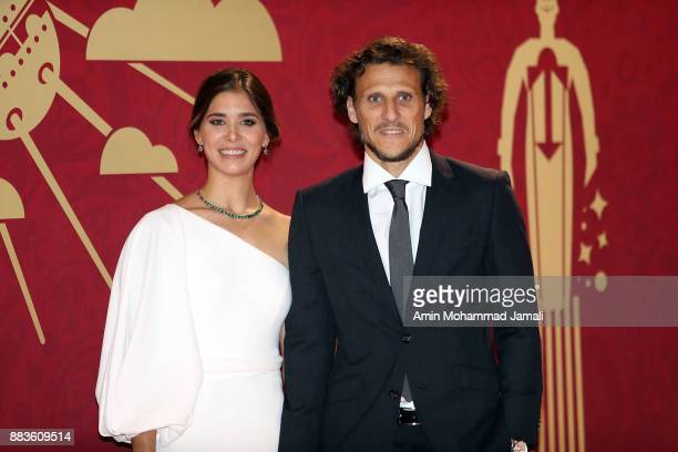 Draw assistant Diego Forlan and his wife Paz Cardoso arrives prior to the Final Draw for the 2018 FIFA World Cup Russia at the State Kremlin Palace...