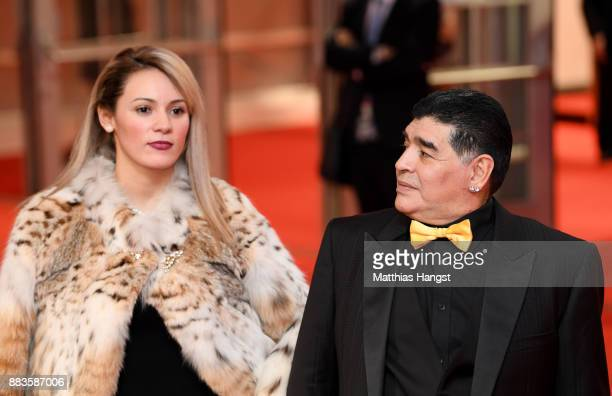 Draw assistant, Diego Maradona and his girlfriend Rocío Oliva arrives prior to the Final Draw for the 2018 FIFA World Cup Russia at the State Kremlin...