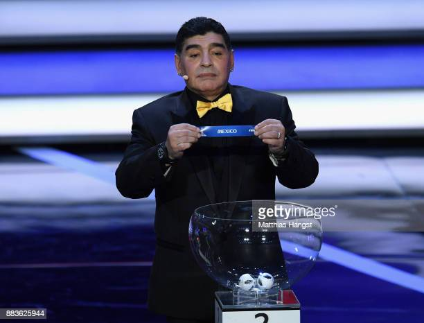 Draw assistant Diego Maradona draws Mexico during the Final Draw for the 2018 FIFA World Cup Russia at the State Kremlin Palace on December 1 2017 in...