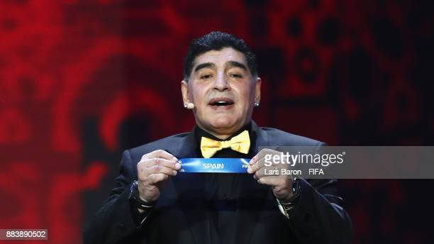 Draw assistant, Diego Maradona draws Spain during the Final Draw for the 2018 FIFA World Cup Russia at the State Kremlin Palace on December 1, 2017...