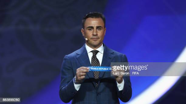 Draw assistant Fabio Cannavaro draws Korea Republic during the Final Draw for the 2018 FIFA World Cup Russia at the State Kremlin Palace on December...