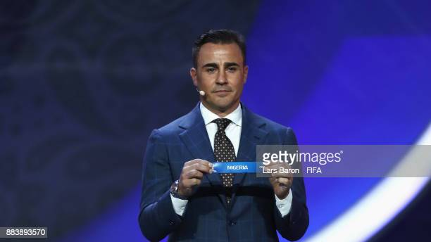Draw assistant Fabio Cannavaro draws Nigeria during the Final Draw for the 2018 FIFA World Cup Russia at the State Kremlin Palace on December 1 2017...