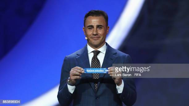 Draw assistant Fabio Cannavaro draws Saudi Arabia during the Final Draw for the 2018 FIFA World Cup Russia at the State Kremlin Palace on December 1...