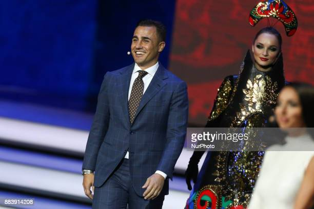 Draw assistant Fabio Cannavaro walks onto the stage during the Final Draw for the 2018 FIFA World Cup Russia at the State Kremlin Palace on December...