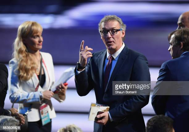 Draw assistant Laurent Blanc makes his way onto the stage during the Final Draw for the 2018 FIFA World Cup Russia at the State Kremlin Palace on...