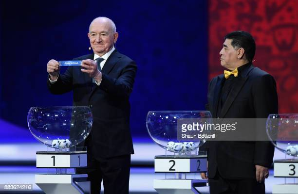 Draw assistant Nikita Simonyan draws Argentina during the Final Draw for the 2018 FIFA World Cup Russia at the State Kremlin Palace on December 1...