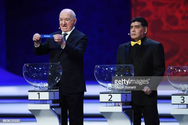 Draw assistant Nikita Simonyan draws Belgium as Draw assistant Diego Maradona looks on during the Final Draw for the 2018 FIFA World Cup Russia at...