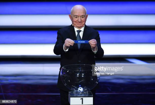 Draw assistant Nikita Simonyan draws Belgium during the Final Draw for the 2018 FIFA World Cup Russia at the State Kremlin Palace on December 1 2017...