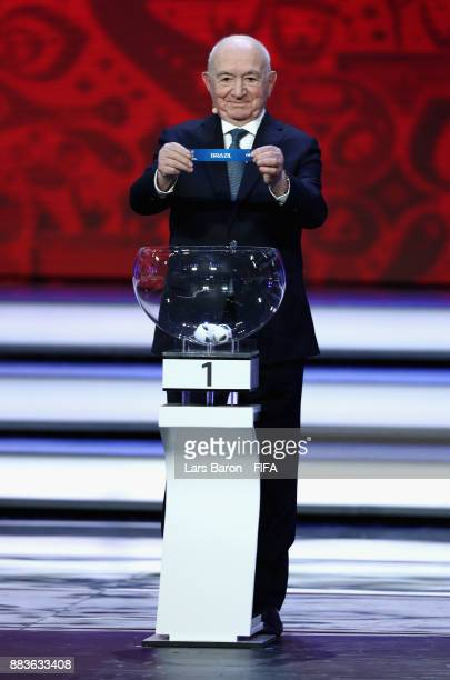 Draw assistant Nikita Simonyan draws Brazil during the Final Draw for the 2018 FIFA World Cup Russia at the State Kremlin Palace on December 1 2017...
