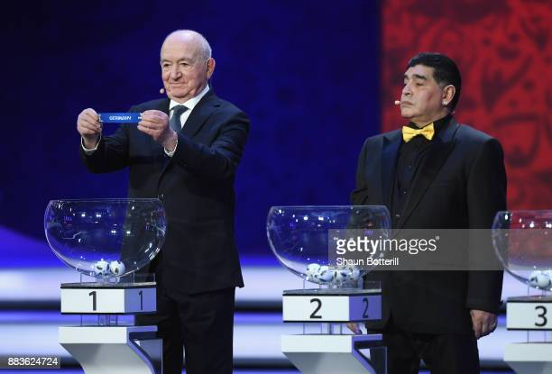 Draw assistant Nikita Simonyan draws Germany as Draw assistant Diego Maradona looks on during the Final Draw for the 2018 FIFA World Cup Russia at...