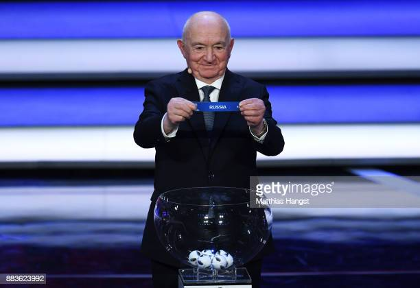 Draw assistant Nikita Simonyan draws Russia during the Final Draw for the 2018 FIFA World Cup Russia at the State Kremlin Palace on December 1 2017...