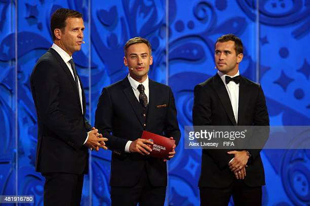 Draw assistant Oliver Bierhoff presenter Dmitry Shepelev and Draw assistant Alexander Kerzhakov on stage during the European Zone Draw during the...