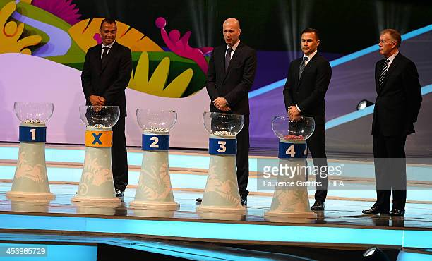 Draw assistants Cafu Zinedine Zidane Fabio Cannavaro and Sir Geoff Hurst wait behind the pots during the Final Draw for the 2014 FIFA World Cup...