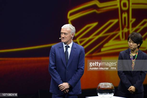 Draw assistants Didier Deschamps and Aya Miyama on stage during the FIFA Women's World Cup France 2019 Draw at La Seine Musicale on December 8 2018...