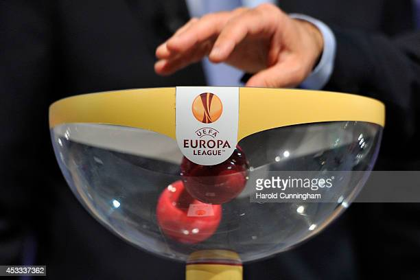 Draw balls are shuffled during the 2014/15 UEFA Europa League Play-off round draw at the UEFA headquarters, The House of European Football, on August...