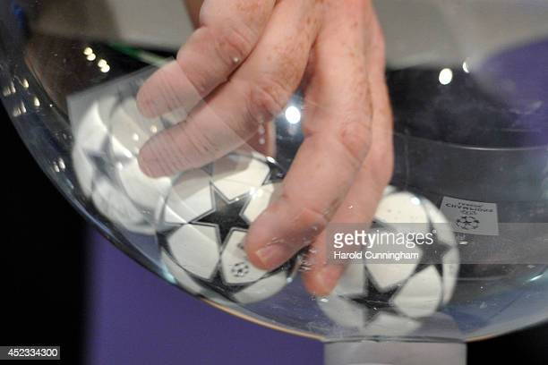 Draw balls are shuffled during the UEFA 2014/15 Champions League third qualifying rounds draw rehersal at the UEFA headquarters, The House of...