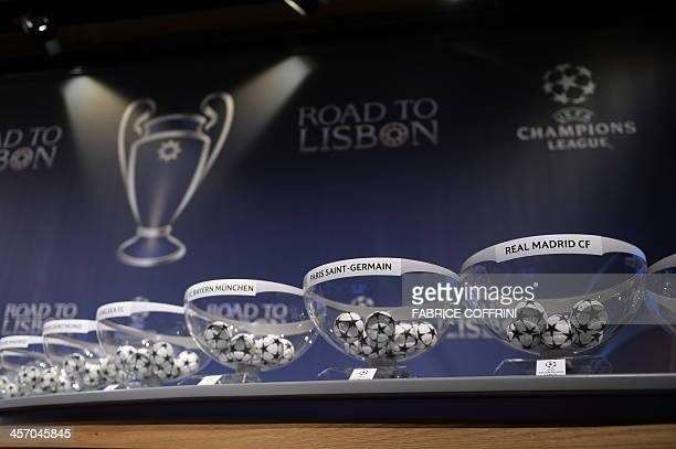Draw balls with the names of the teams sit on a table at the start of the draw for the last 16 of the UEFA Champions league tournament at the UEFA...