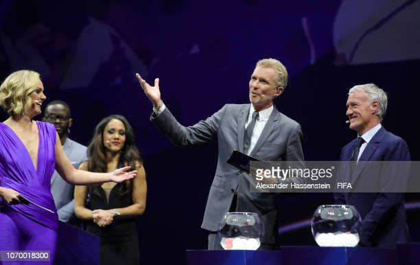 Draw moderators Denis Brogniart and Amanda Davies on stage with draw assistant Didier Deschamps of France during the FIFA Women's World Cup France...