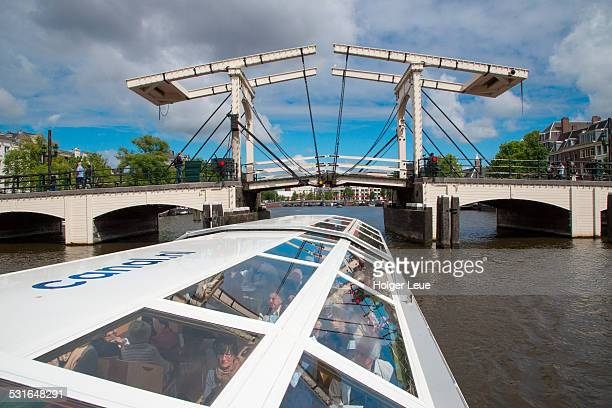 drawbridge across canal seen from sightseeing boat - tourboat stock pictures, royalty-free photos & images