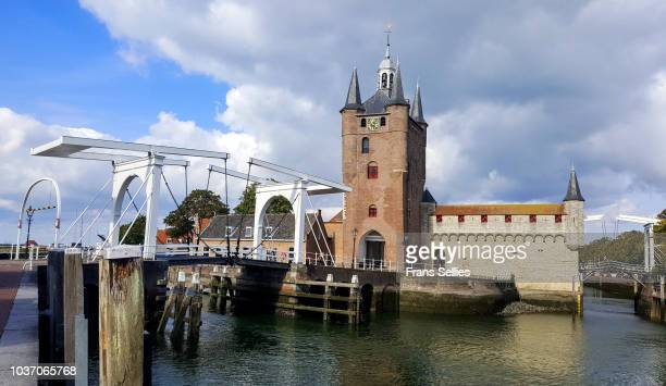 drawbridge and the city gate at the old harbor in zierikzee, zeeland, the netherlands - zeeland stock pictures, royalty-free photos & images
