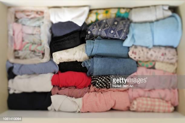 drawer full of organized young girl clothing - rafael ben ari stock-fotos und bilder