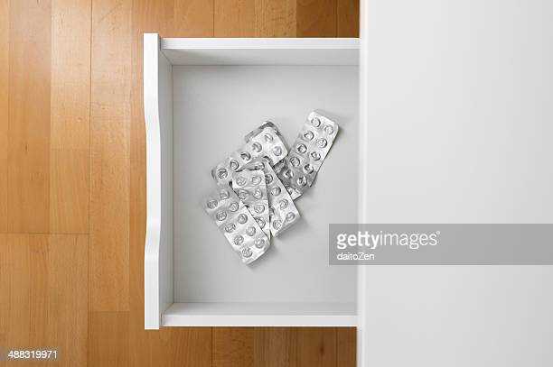 drawer with empty blister packs of pills - drawer stock pictures, royalty-free photos & images