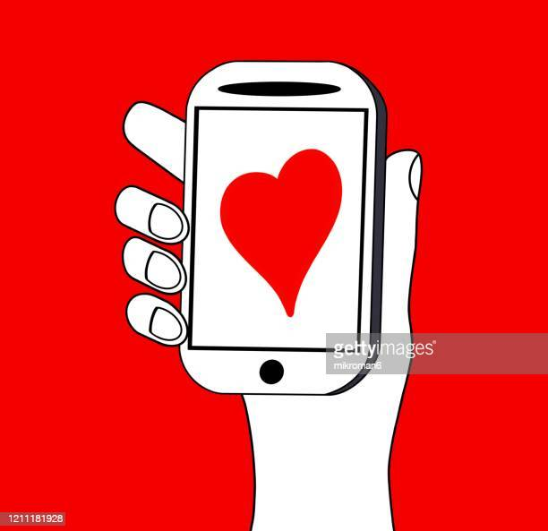 drawing a hand holding a smartphone - mobile app stock pictures, royalty-free photos & images