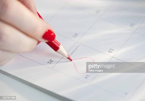 Drawing a heart on a calendar