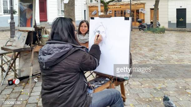 drawing a portrait at place du tertre paris - drawing artistic product stock pictures, royalty-free photos & images