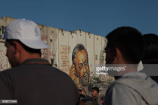 Drawing Artistic image of Marwan Barghouti on the Israeli wall at Qalandia checkpoint on July 10 2015