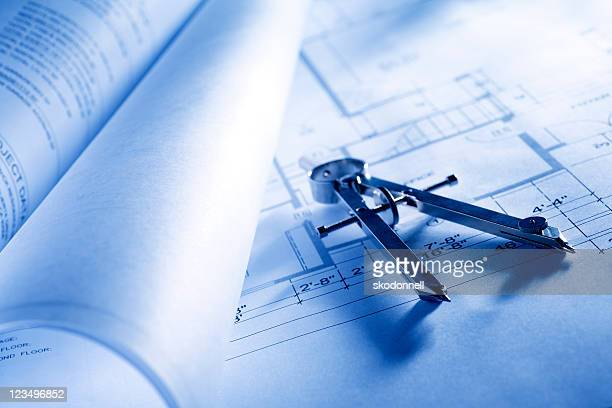 drawing compass on blueprints