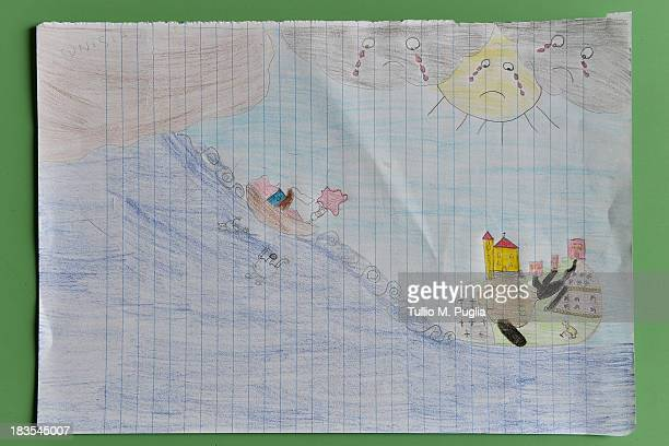 A drawing created by a student relating to the recent shipwreck off the Italian coast are displayed in the Elementary School of Lampedusa on October...
