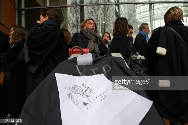 Drawing depicting Justice and reading 'Emmanuel kills me' Lawyers counsels and magistrates gathered in front of the Toulouse' courthouse for a day...