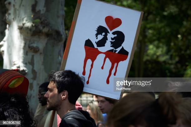 A drawing depicting US President Trump and French President Macron in love with blood A quotmaree populairequot demonstration was called by more than...